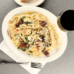 Enjoy pasta dinner and wine in Eugene at The Embers